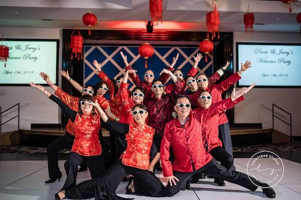 Sangeet - Chinese lanterns - multicultural wedding celebration - groom's family dancing