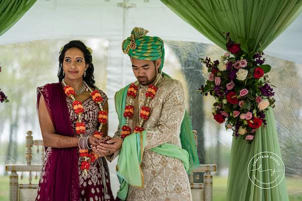 Indian wedding ceremony - multicultural wedding - Hindu wedding ceremony - bride and groom on mandap