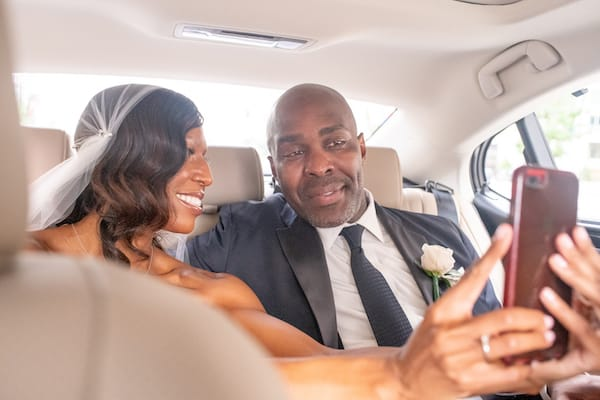 Philadelphia wedding - bride and groom in car taking selfie