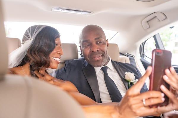 Philadelphia wedding - bride and groom in car taking selfie