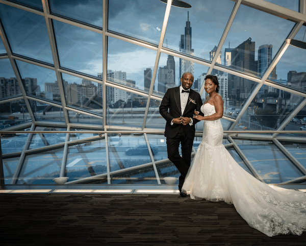 bride and groom with Philadelphia skyline in the background