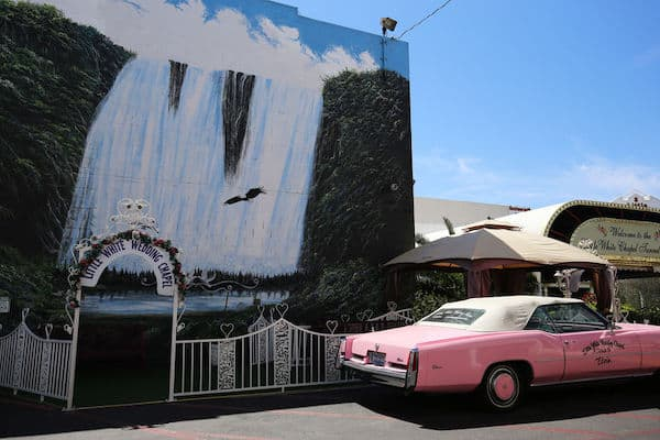 Las Vegas wedding chapel with a pink Cadillac sitting out front