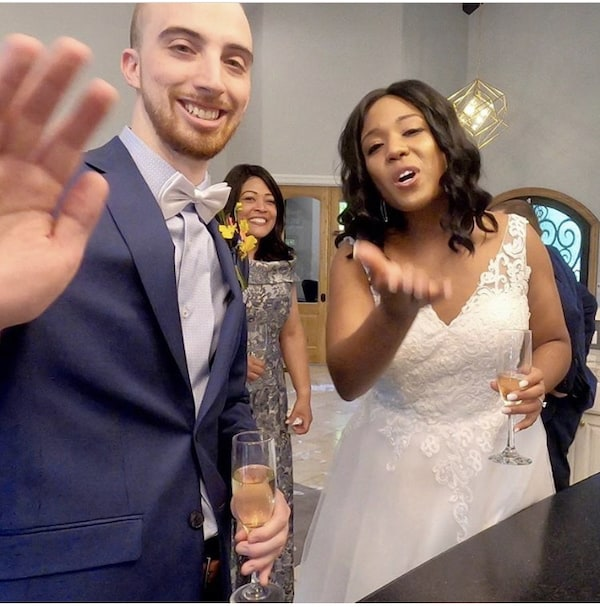 bride and groom waving to guests on Zoom