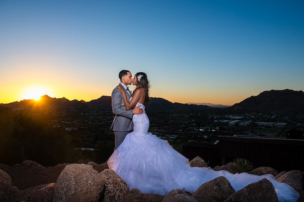 newlyweds posing for sunset photos at their Arizona destination wedding