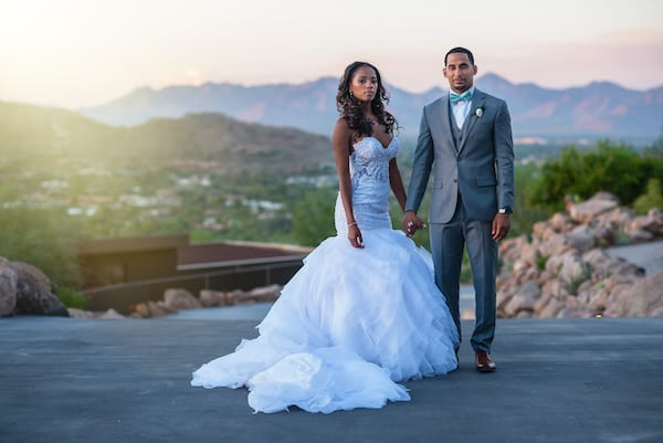 Bride and groom posing for wedding photos at the Sanctuary Camelback Mountain Resort in Arizona