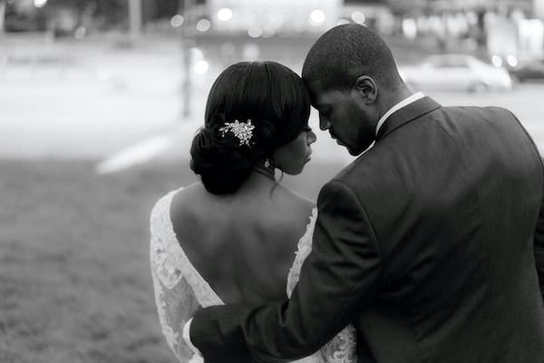 black bride and groom snuggling