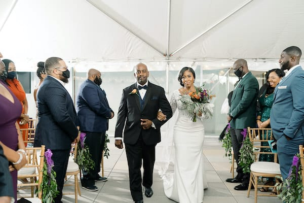 bride being escorted down the aisle by her father at her Independence Visitor Center wedding in Philadelphia