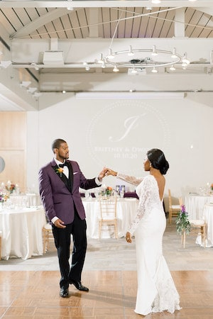 bride and groom dancing to their first dance to All of Me by John Legend