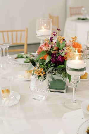 modern wedding centerpieces with purple and orange flowers