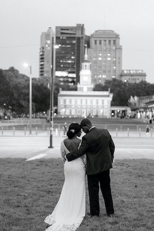 black and white photo os a bride and groom in front of Independence Hall in Old City Philadelphia