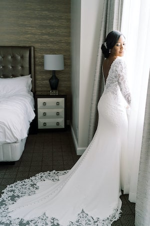 bride at window in her Ritz-Carlton Philadelphia hotel room