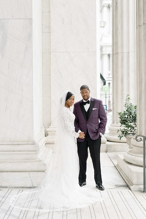 bride and groom on the steps of the Ritz Carlton Philadelphia