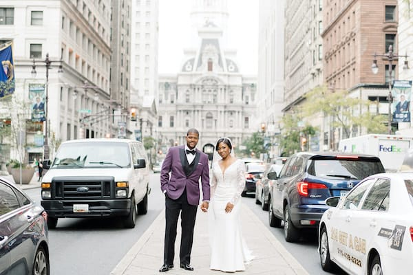 bride and groom on Board Street in front of  Philadelphia City Hall