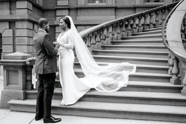 bride and groom on the steps of the Union League of Philadelphia