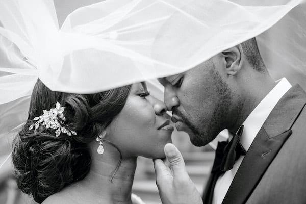 Philadelphia bride and groom kissing under her wedding veil