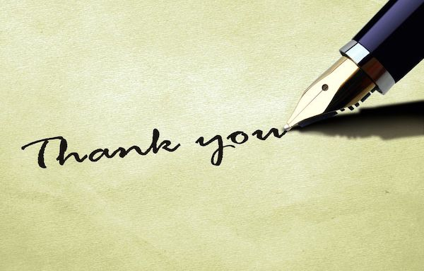 Calligrapher writing Thank You with an ink pen