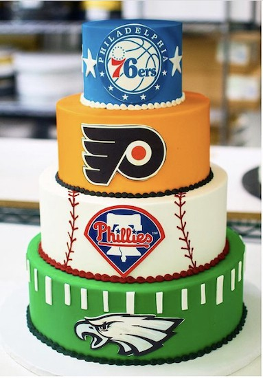 An iconic Philly wedding cake representing the Eagles, Phillies, Flyers and 76ers by Bredenbeck's Bakery