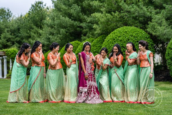 Philadelphia South Asian bride with her wedding party in colorful traditional attire