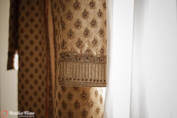 beautiful detailing on a South Asian groom's jacket