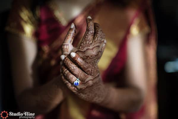 hands of a South Asian bride with intricate henna