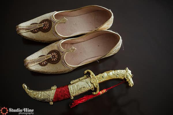 gold shoes and accessories for a South Asian groom