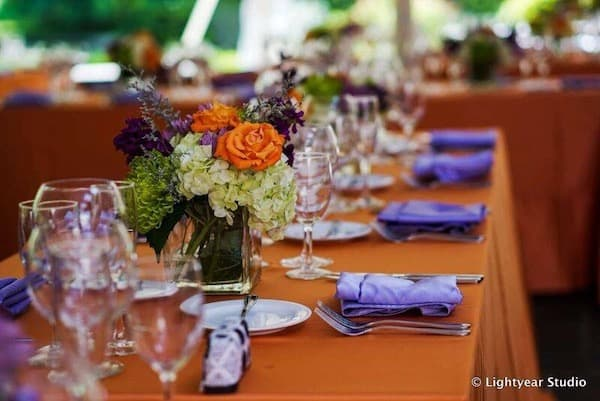 colorful orange and purple decor at a Philadelphia South Asian wedding reception