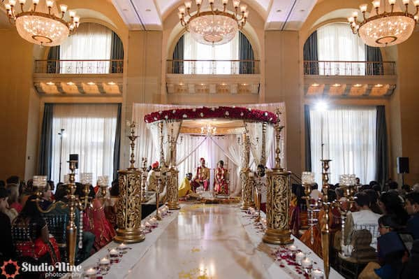 Gold mandap and aisle decor at a Philadelphia South Asian wedding ceremony