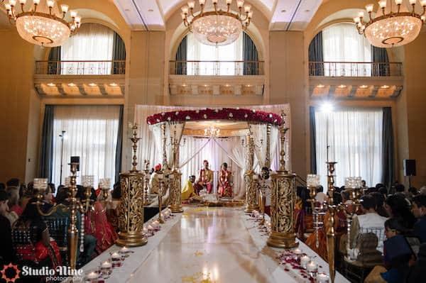 Gold mandap and aisle decor at a Philadelphia South Asian wedding ceremony