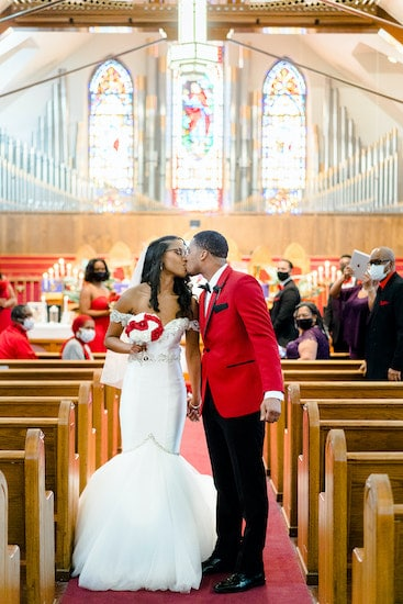 bride and groom kissing after their intimate socially distant wedding at St Matthew AME in Philadelphia