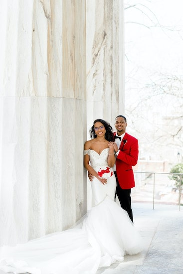 bride and groom on the steps of the Merchant Exchange in historic Old City Philadelphia