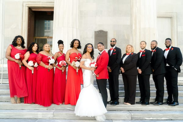Bride and groom with their wedding party in Old City Philadelphia - red is the groom's favorite color