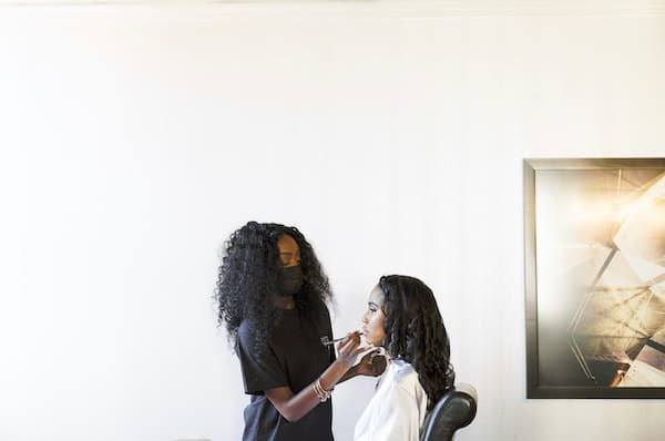 Philadelphia makeup artist wearing mask as she applies make up to a bride