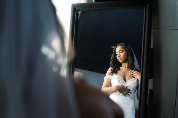 Philadelphia bride look at herself in a mirror at the Notary Hotel