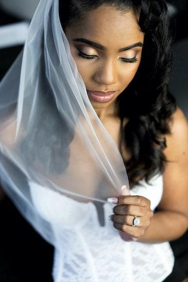 Philadelphia bride posing for photos before her intimate wedding