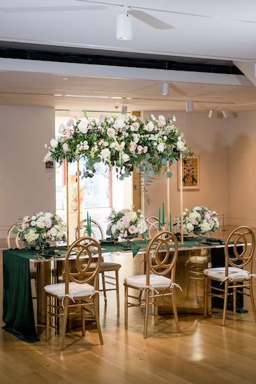 Glam hunter green and gold reception table at PAFA