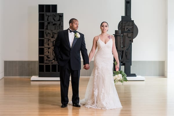 Black bride and groom in the Hamilton Gallery at the Pennsylvania Academy of the fine arts in Philadelphia