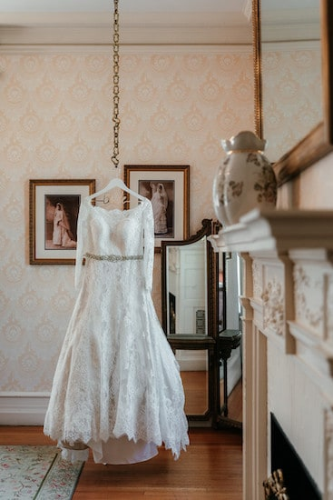 bride's wedding gown hanging in the dressing room at Cairnwood Estate