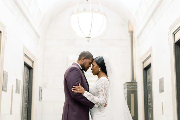 bride and groom posing for wedding photos at the Ritz Carlton Philadelphia