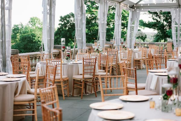 elegant gold, red and white wedding decor on the South Terrace of Cairnwood Estate