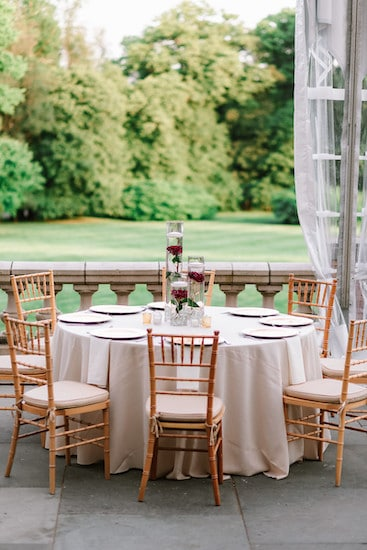 gold, red and white tablescapes on the south terrace at Cairnwood estate