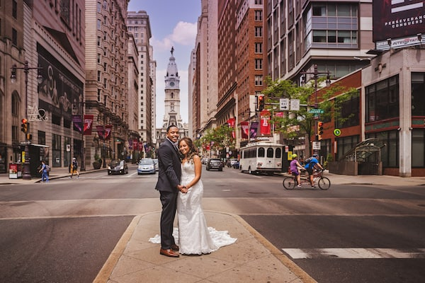 Bride and groom on South Broad Street in front of Philadelphia's City Hall