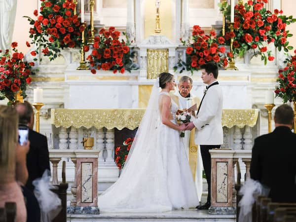 bride and groom exchanging wedding vows at The National Shrine of St Rita of Cascia in Philadelphia