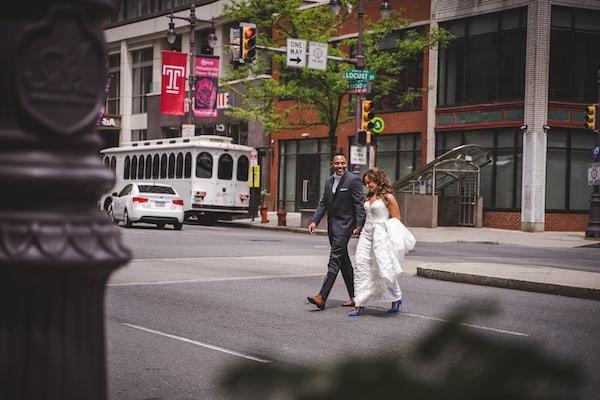 bride and groom crossing South Broad Street in Philadelphia