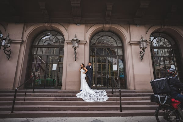 bride and groom in front of the Academy of Music in Philadelphia