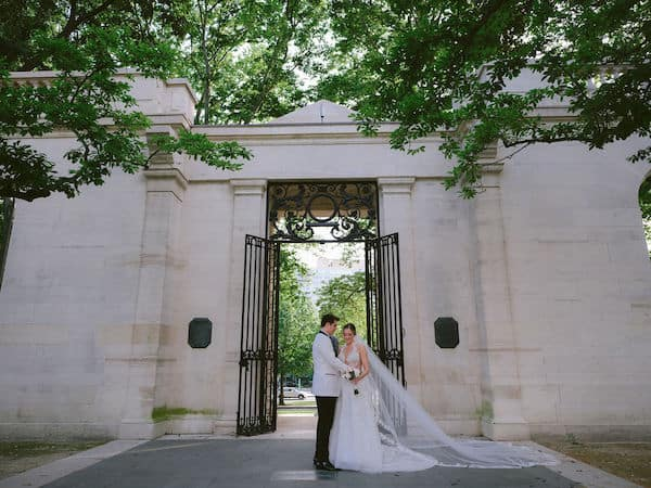 bride and groom at the gate to the Rodin Museum in Philadelphia