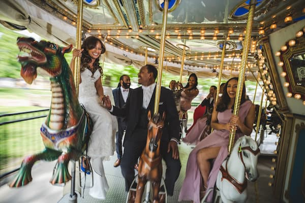 bride and groom with wedding party riding the Park Liberty Carousel in Franklin Square