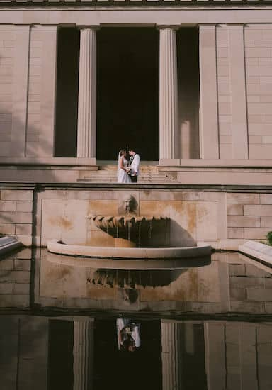 reflection of bride and grooming the fountain at the Rodin Museum in Philadelphia