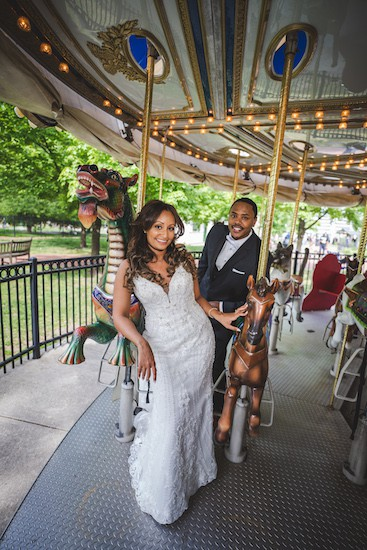 brid mand groom riding the Park Liberty Carousel in Franklin Square