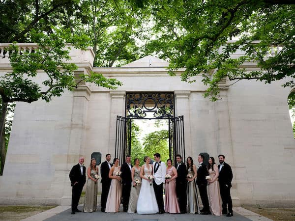 Newlywed couple with their wedding party at the Rodin Museum
