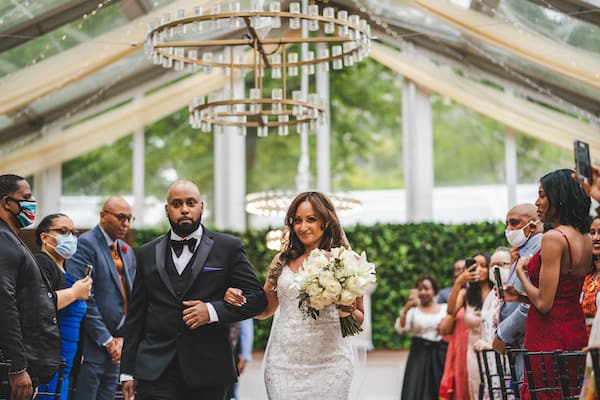 bride being walked dow the aisle by her brother at Cescaphe Franklin's View in Philadelphia